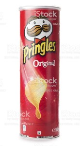 St Ives, England - October 20, 2011: A tube of Pringles original potato chips isolated on white background. Pringles are produced by Procter & Gamble and sold in more than 140 countries.